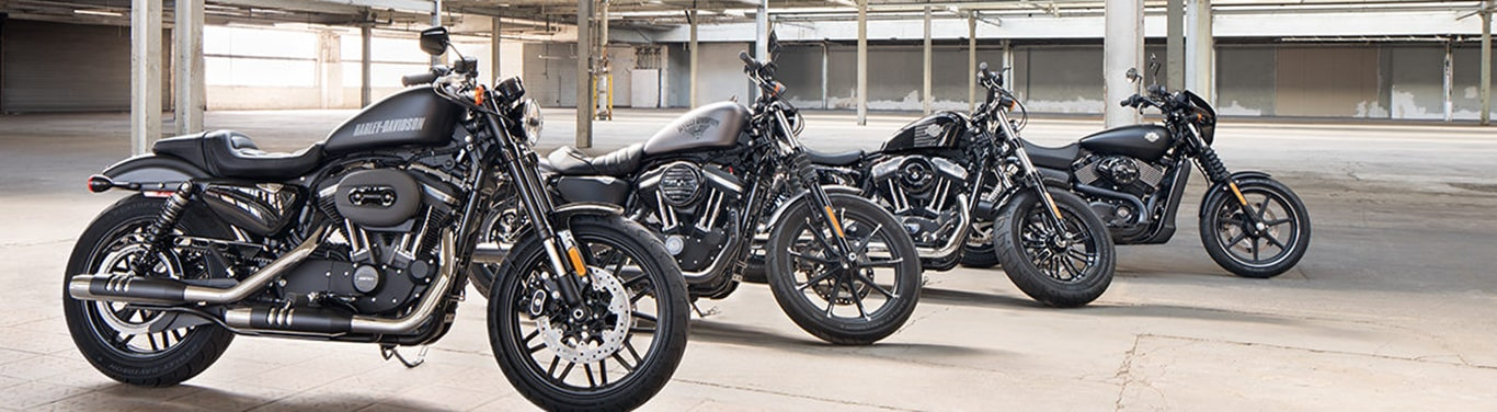 Three H-D motorcycles parked in empty warehouse