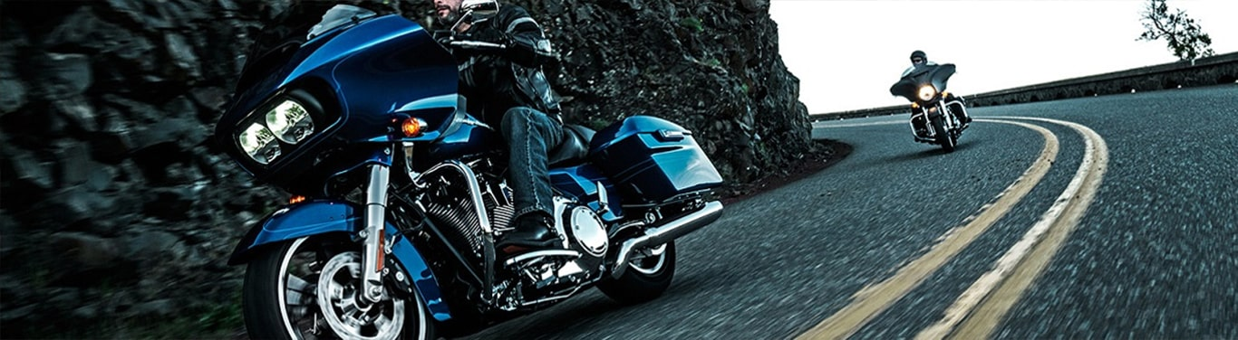 Two H-D Motorcycle riding on the road.