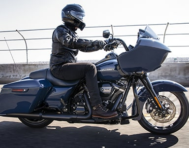 Male riding a Blue Harley-Davidson® motorcycle