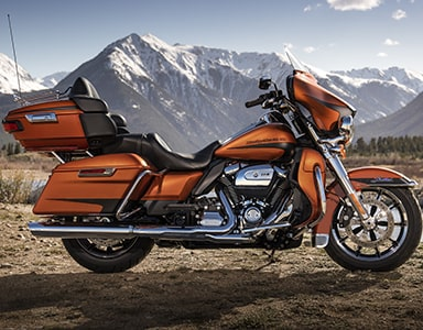 Orange Harley-Davidson® parked with moutain in background